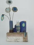 Cat and Vase by Shirley Vauvelle, Sculpture, Earthenware, driftwood, waveworn beach find and vintage text.