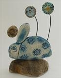 Rabbit and tiny flowers by Shirley Vauvelle, Sculpture, earthenware and driftwood